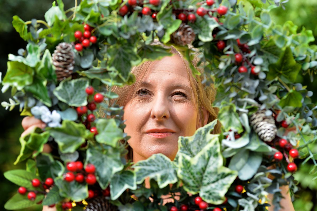 Julie Peters makes faux silk floral wreaths that can adorn doors and greet friends and family all year round