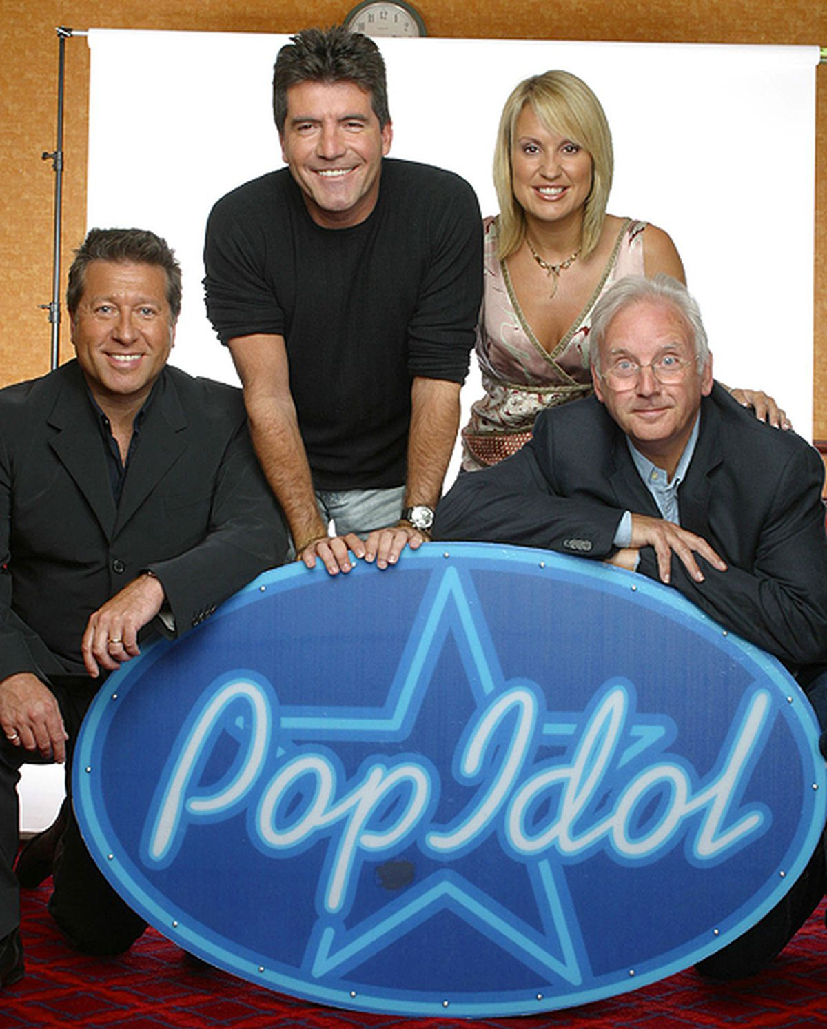 Pete Waterman, Neil Fox, Nicki Chapman and Simon Cowell pose for a picture promoting Pop Idol in 2003