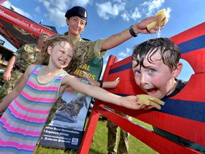 From the Royal Engineers, based in Oldbury, is medic: Hayley Simpson, with Ruben George, nine, getting a soak whilst Rosalie George, aged seven, gives a hand.