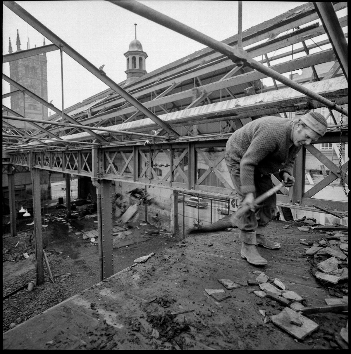 George captured one of the demolition men shovelling rubble from just beneath the roof beams