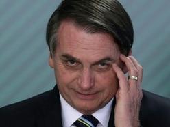 Brazil's Bolsonaro recovering from Covid-19 'due to taking anti-malaria drug'