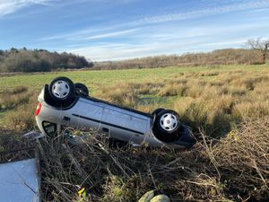 The overturned car. Photo: WMFSWestBrom