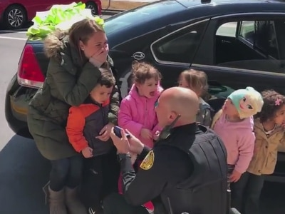 Watch a police officer propose to his girlfriend in front of her students