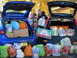 Reporters Jordan Harris and Heather Large with helper Phil Beecher and the huge amount of food donated for the Feed A Family campaign