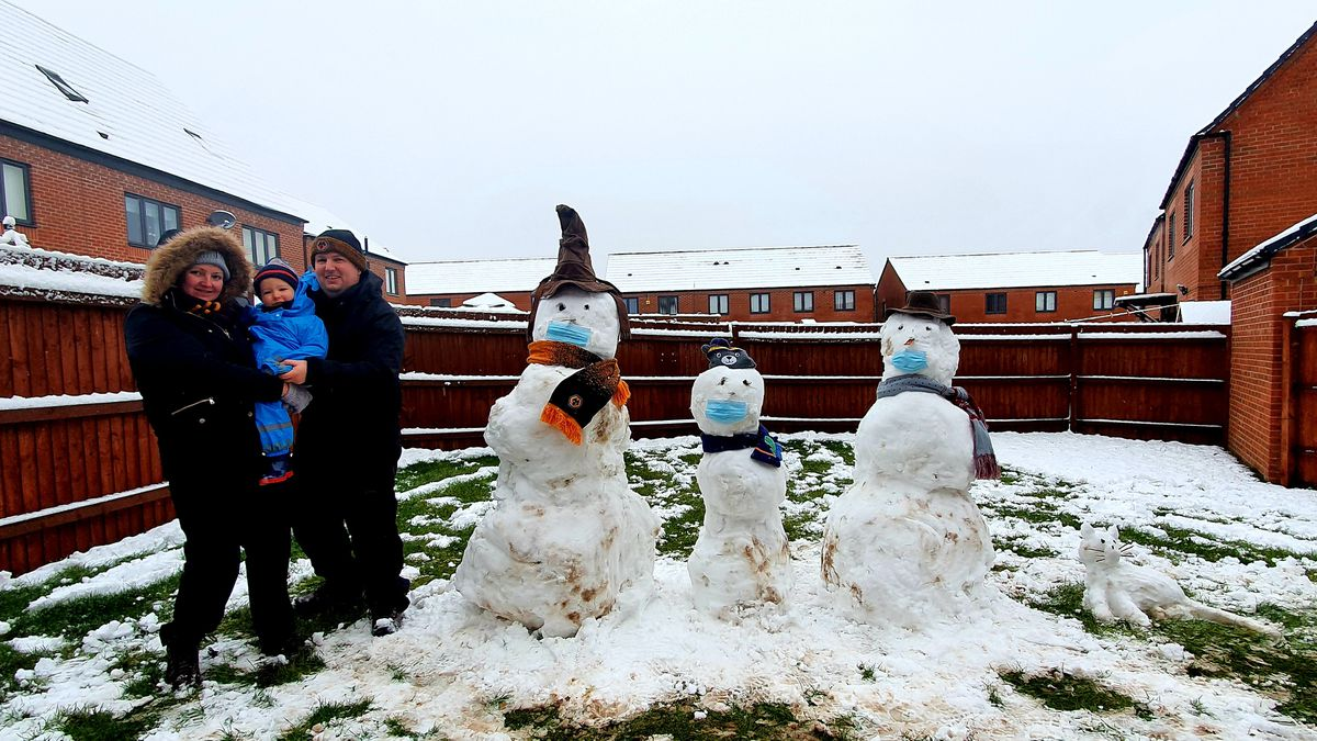 Nicole, Matthew and James Bunce with their snowmen in Wolvehrampton