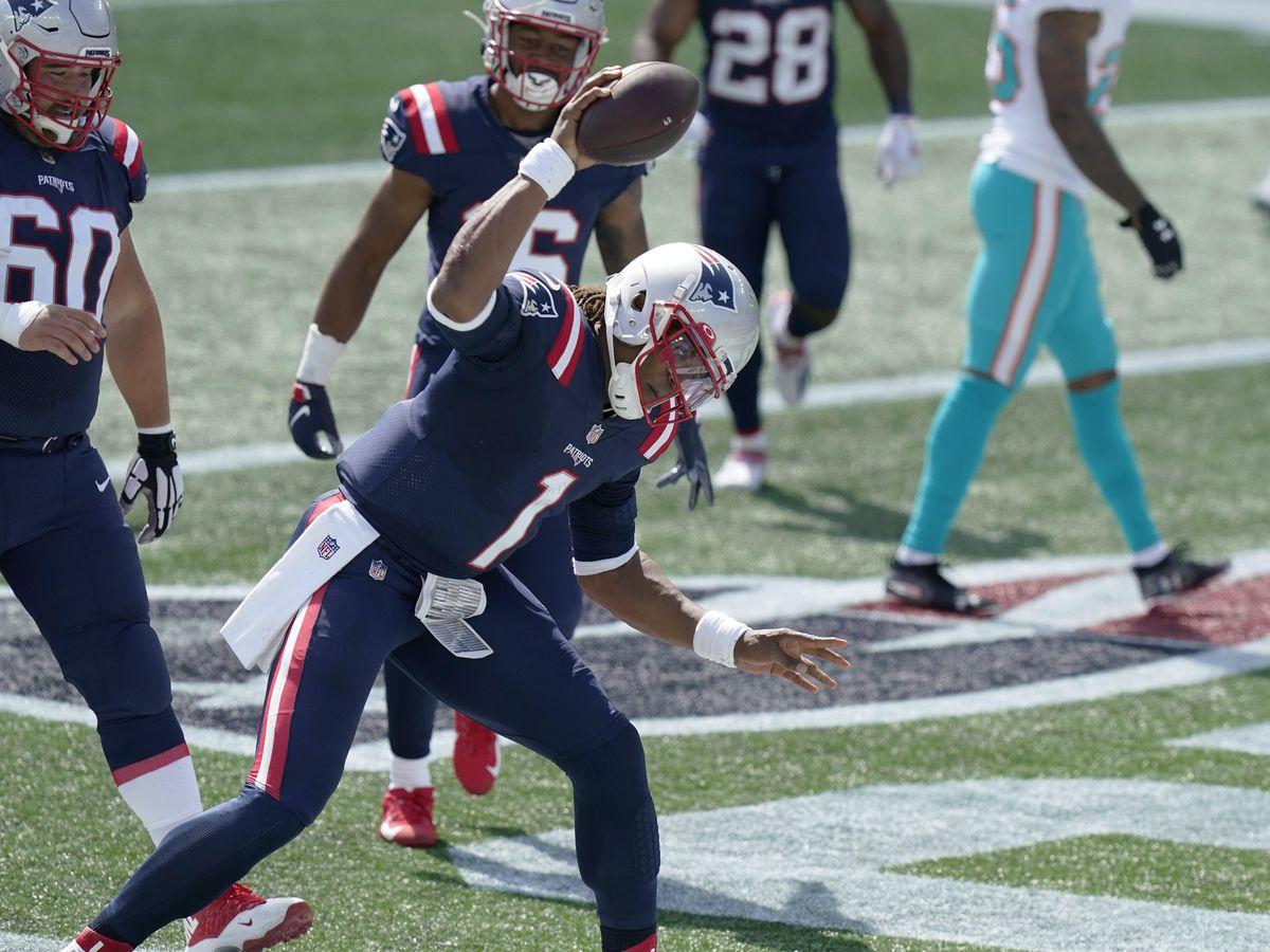 New England Patriots quarterback Cam Newton celebrates his rushing touchdown against the Miami Dolphins