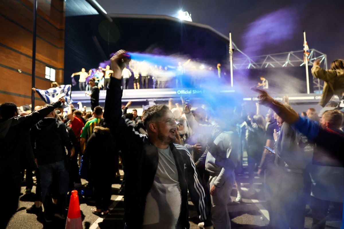 Fans of West Bromwich Albion celebrate outside the stadium. Photo: AMA