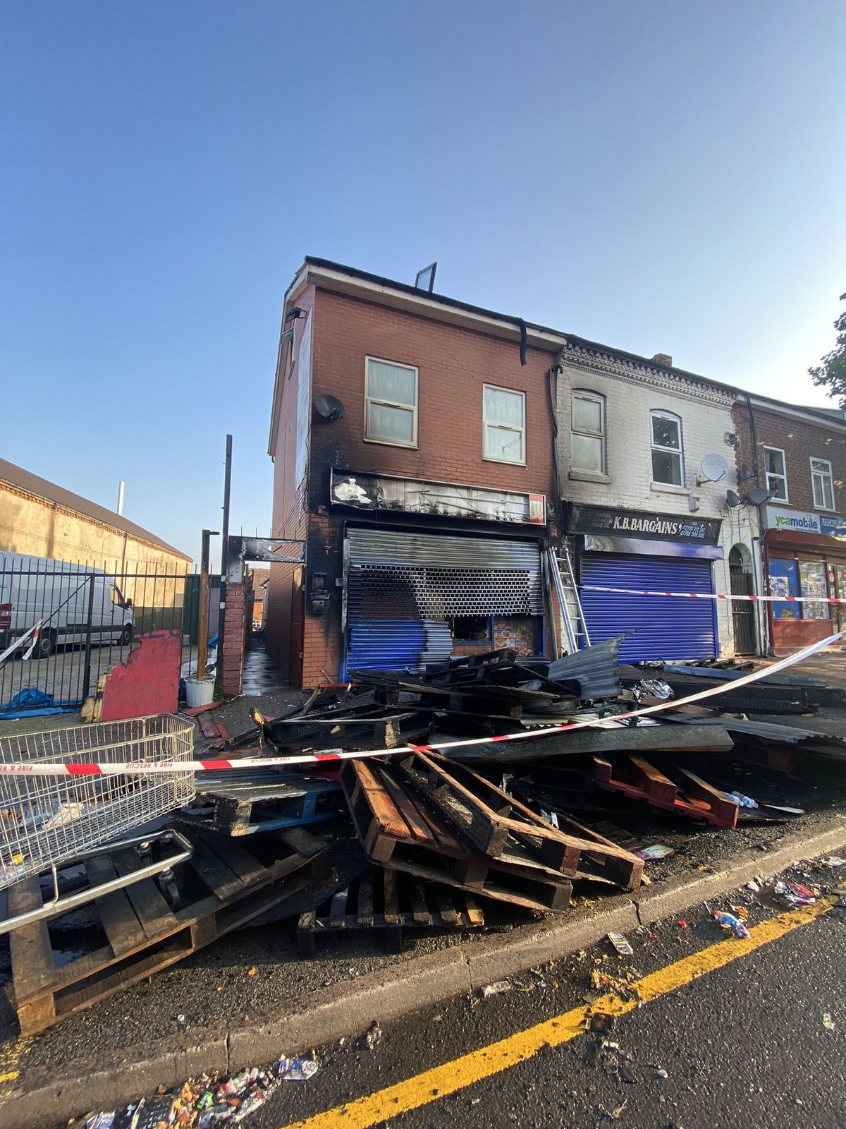 The frontage was completed destroyed by the fire, which threatened to spread to the inside of the property and the adjoining shops (Image by Ward End Fire Station)