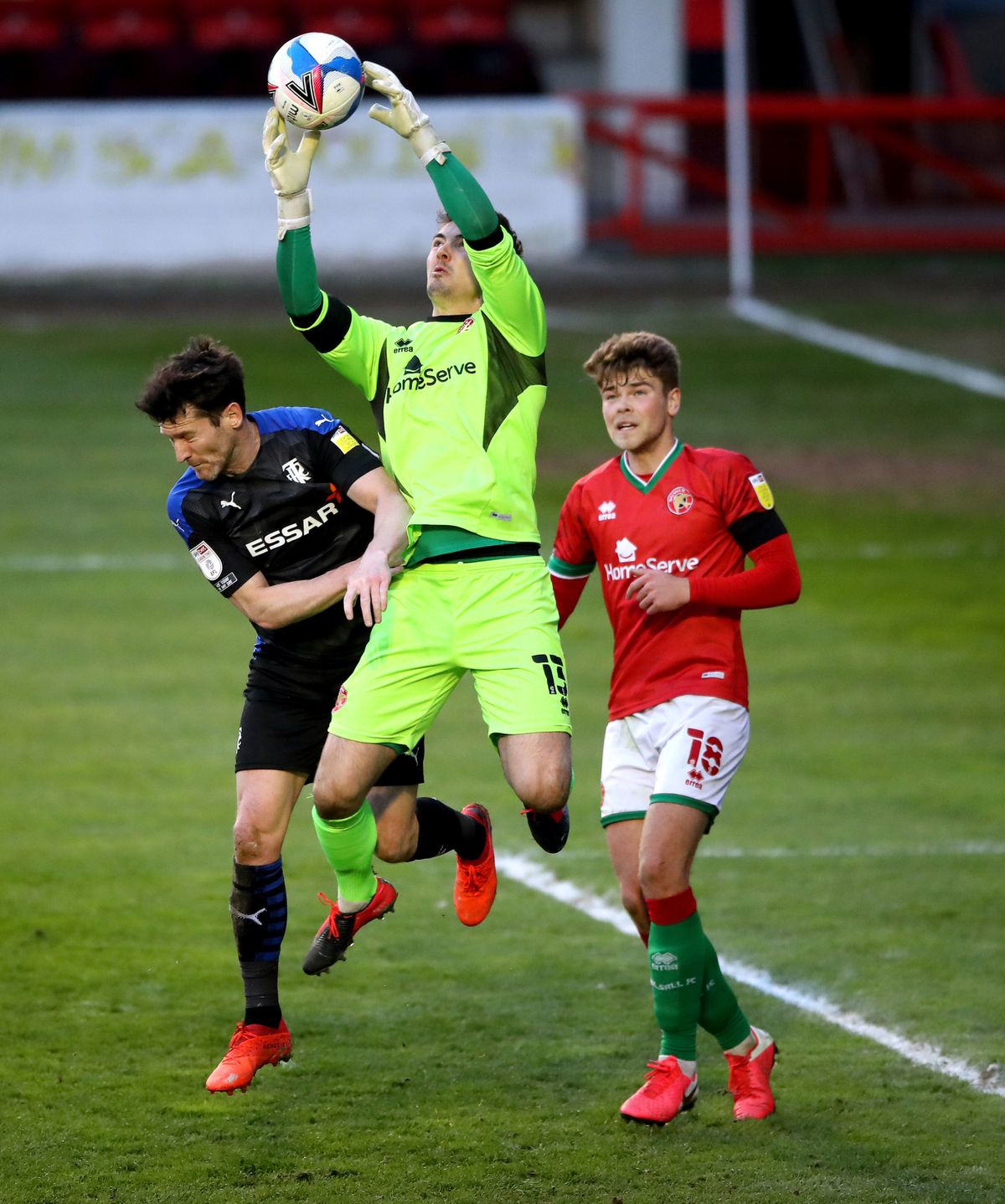 Walsall goalkeeper Jack Rose (centre) and Tranmere Rovers' David Nugent battle for the ball
