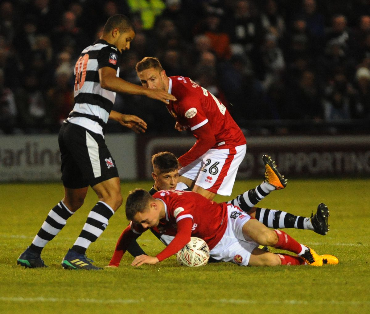 Liam Kinsella battles for the ball..