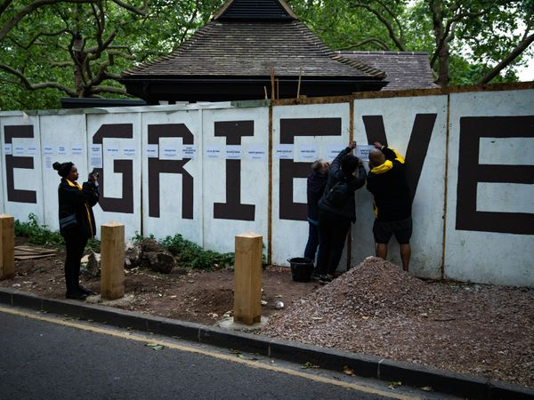 Names are added to a memorial wall on Clapton Common in London, listing local people who have died from Covid-19 and other non-coronavirus related causes during the outbreak (Aaron Chown/PA)