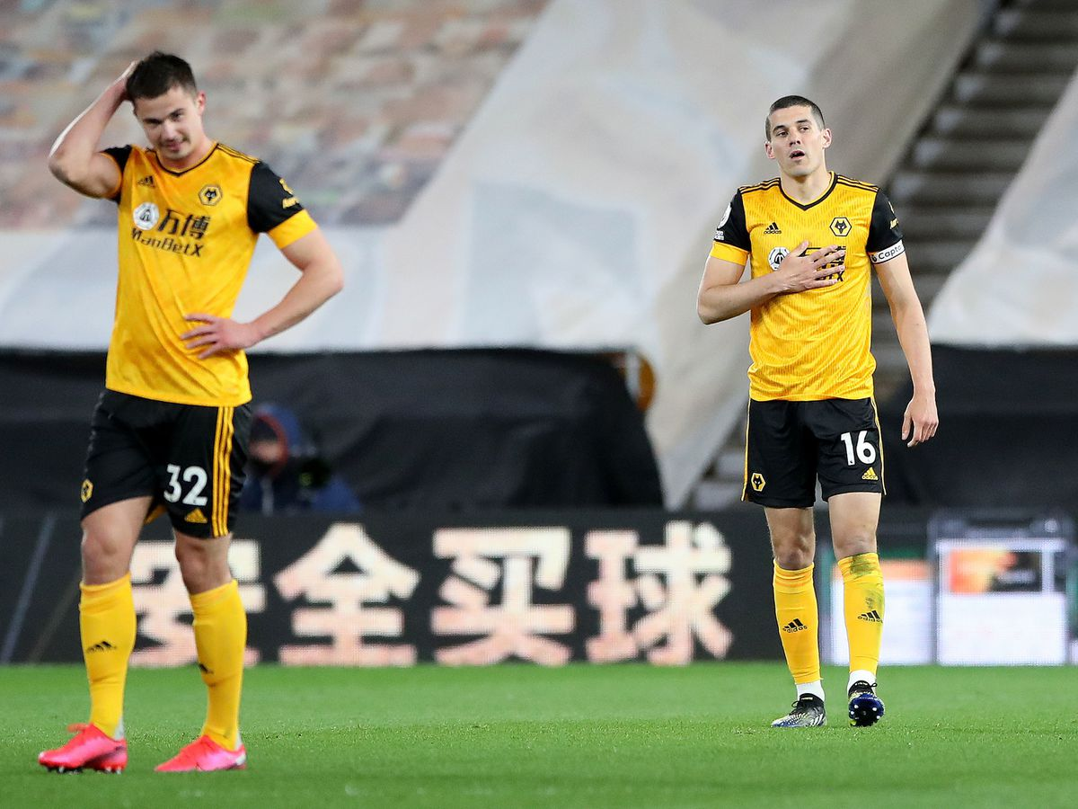 """Wolverhampton Wanderers' Conor Coady (right) and Leander Dendoncker appear dejected during the Premier League match at the Molineux Stadium, Wolverhampton. Issue date: Monday April 5, 2021. PA Photo. See PA story SOCCER Wolverhampton. Photo credit should read: Nick Potts/PA Wire...RESTRICTIONS: EDITORIAL USE ONLY No use with unauthorised audio, video, data, fixture lists, club/league logos or """"live"""" services. Online in-match use limited to 120 images, no video emulation. No use in betting, games or single club/league/player publications.."""