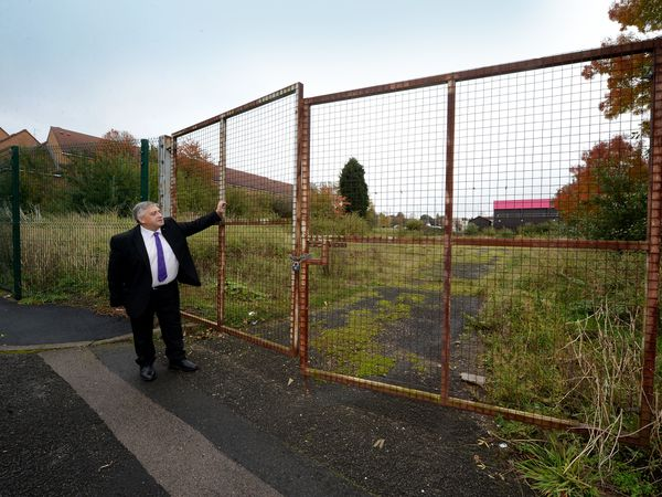 Councillor Peter Hughes next to the land earmarked for a new health centre in Wednesbury