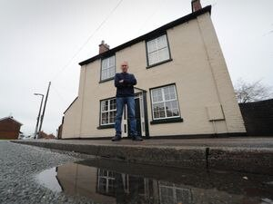 WALSALL PIC  / DAVID HAMILTON PIC / EXPRESS AND STAR PIC 14/01/21 Unhappy with a blocked drain outside his home, Alan White, of Cheslyn Hay..