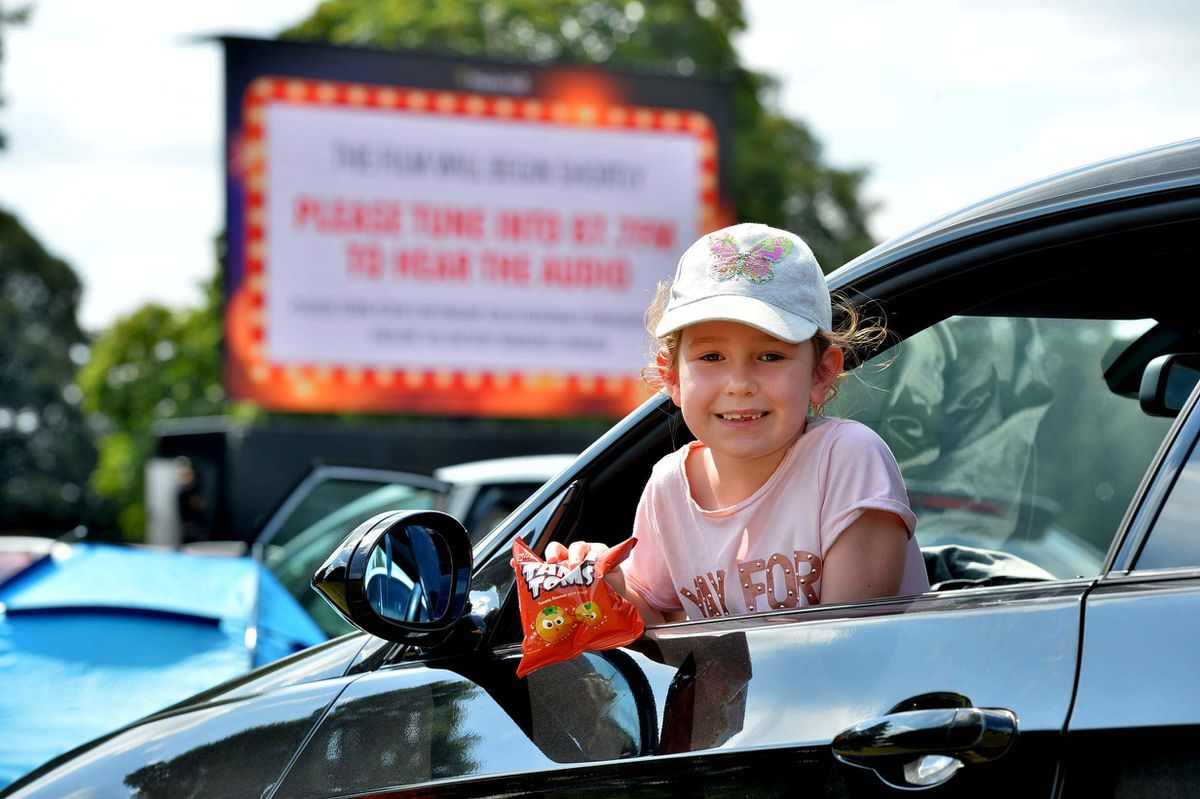 Chelsea Williams (6) from Wednesbury waits with excitement for the film to start