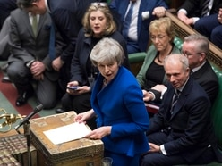 Theresa May offers cross-party talks after surviving bid to oust her as PM