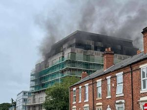 Smoke billows from the Society House building in West Bromwich. Photo: Sandwell Crime Prevention Panel