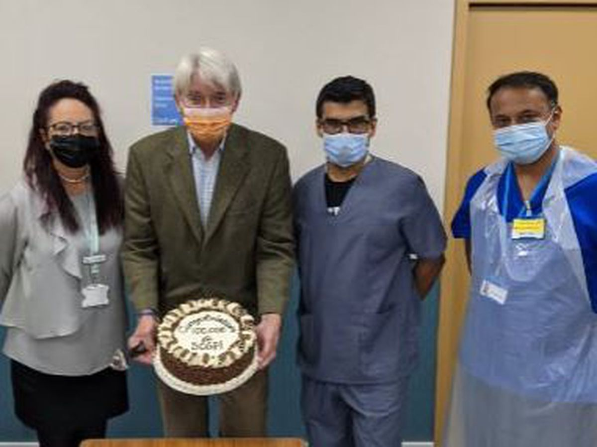Dr Rahul Dubb, Andrew Mitchell MP and members of the vaccine team