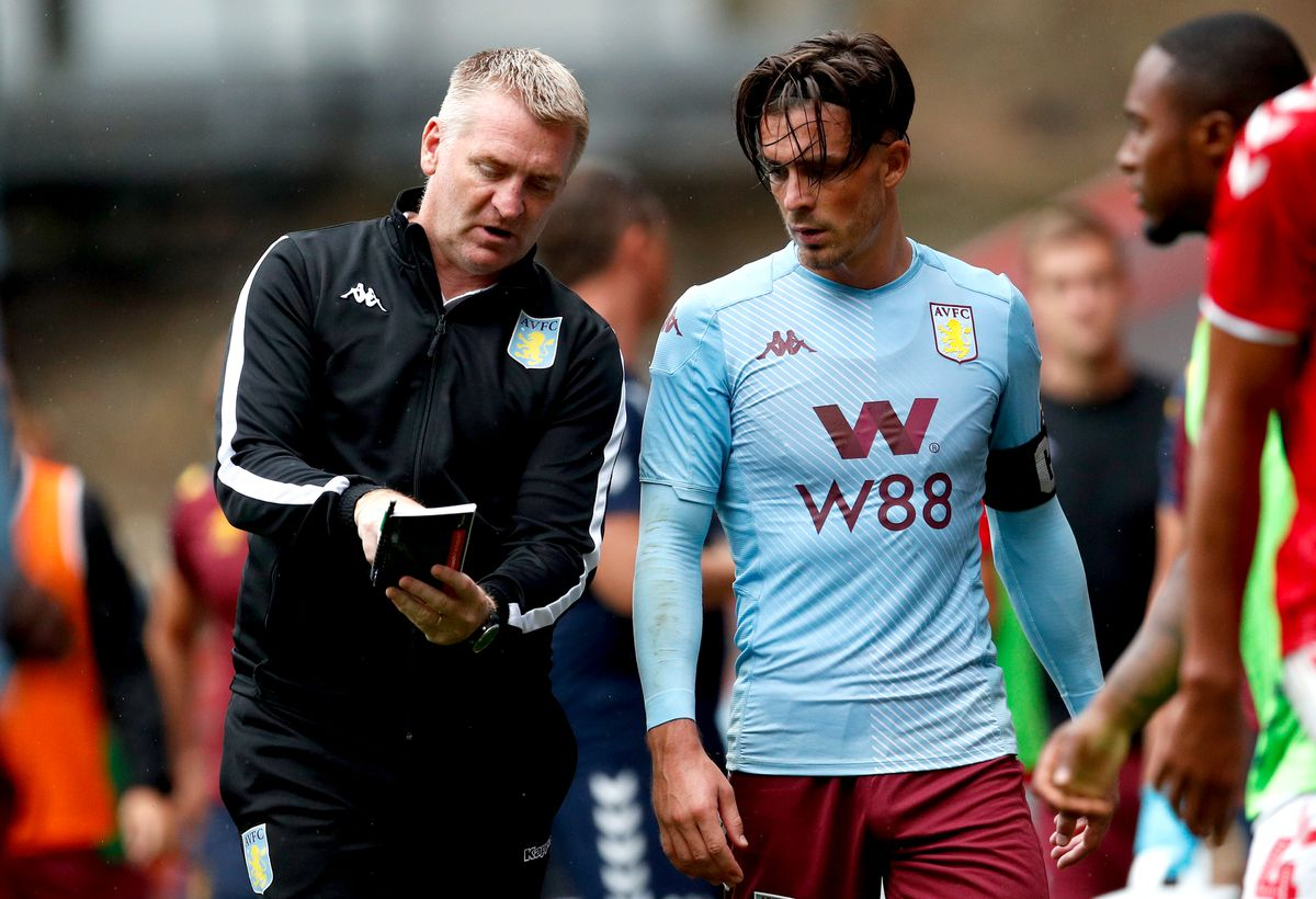 Aston Villa manager Dean Smith (left) speaks to Jack Grealish