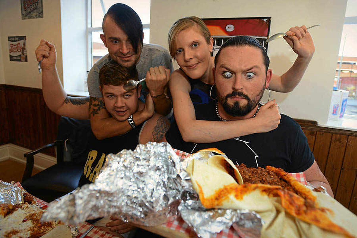 Wrestlers defeated in burrito contest