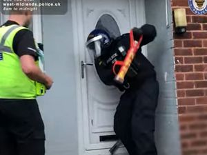 Police carrying out the raid. Photo: West Midlands Police