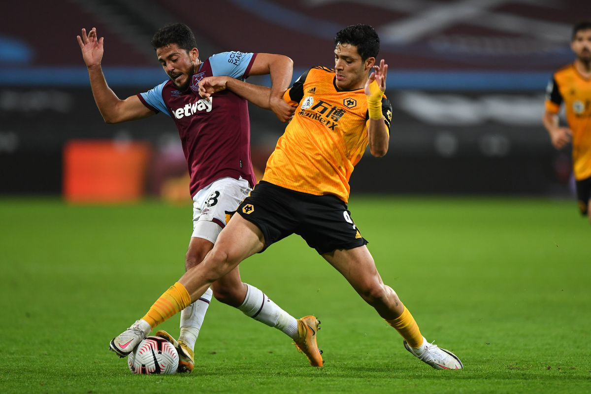 Pablo Fornals of West Ham United and Raul Jimenez of Wolverhampton Wanderers (AMA)