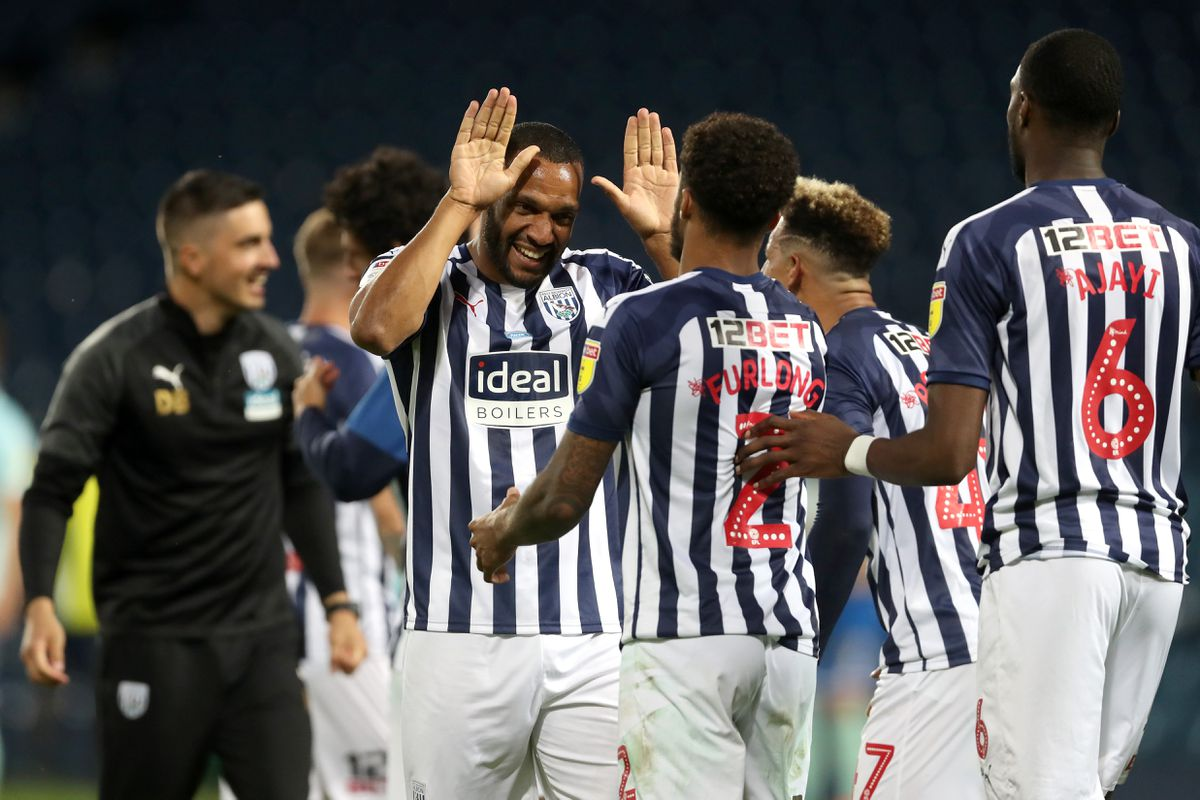 Matt Phillips of West Bromwich Albion and Darnell Furlong of West Bromwich Albion celebrate promotion to the Premier League on the pitch at the end of the match. (AMA)