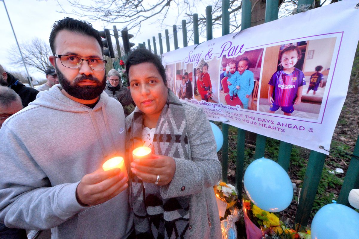 Mother and father Arathi and Jaswinder at a vigil for their sons