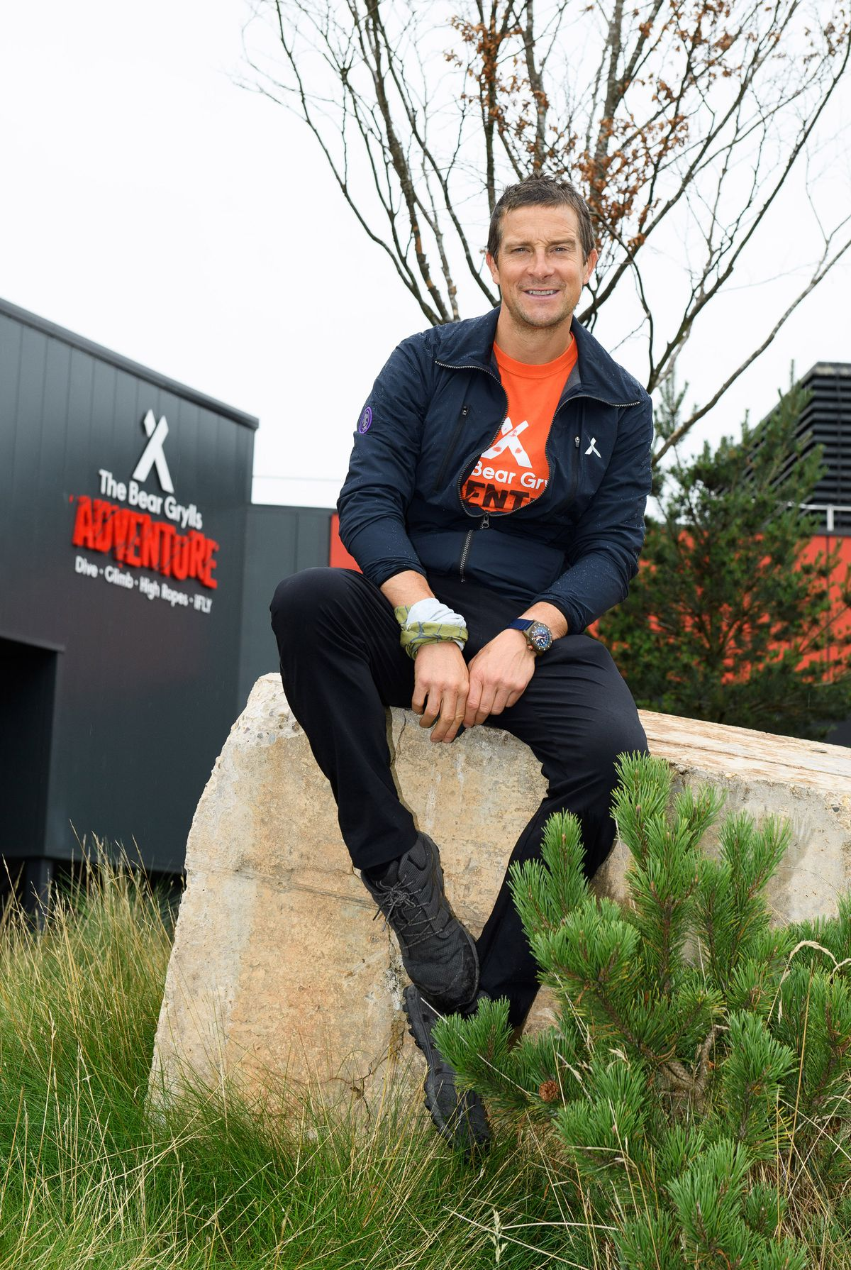 Bear Grylls outside the attraction.