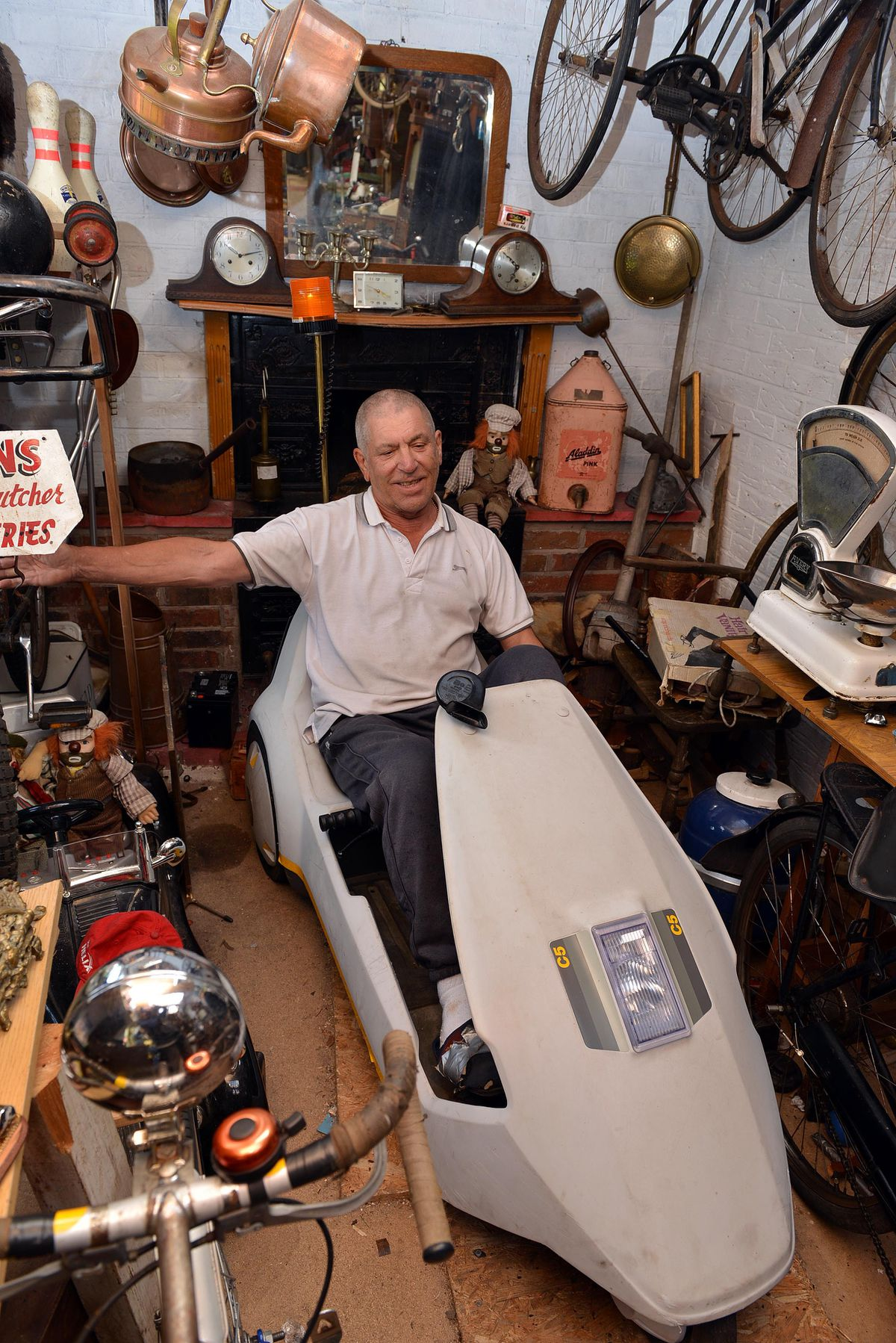 Collector Jake Pearson, pictured in his Sinclair C5
