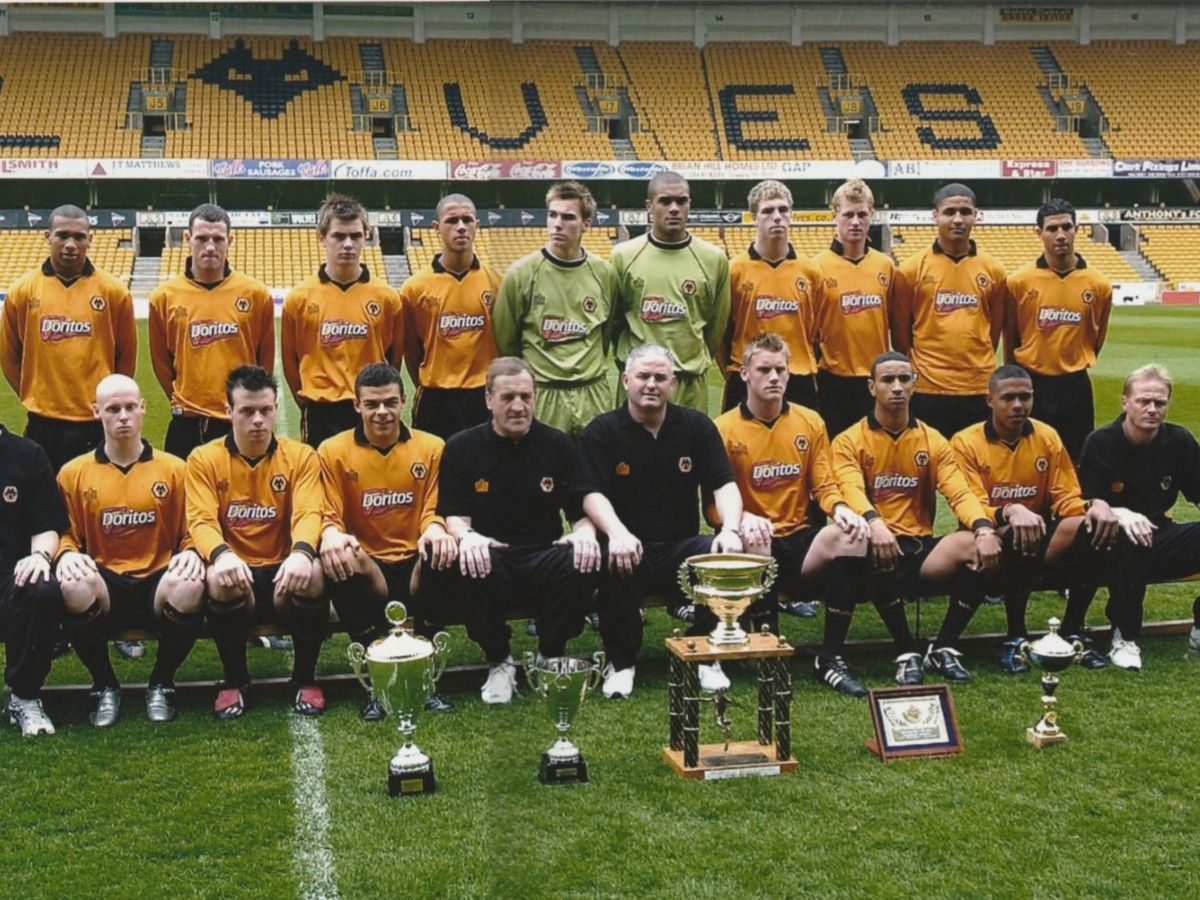Scott Brown in Wolves colours alongside a young Carl Ikeme.