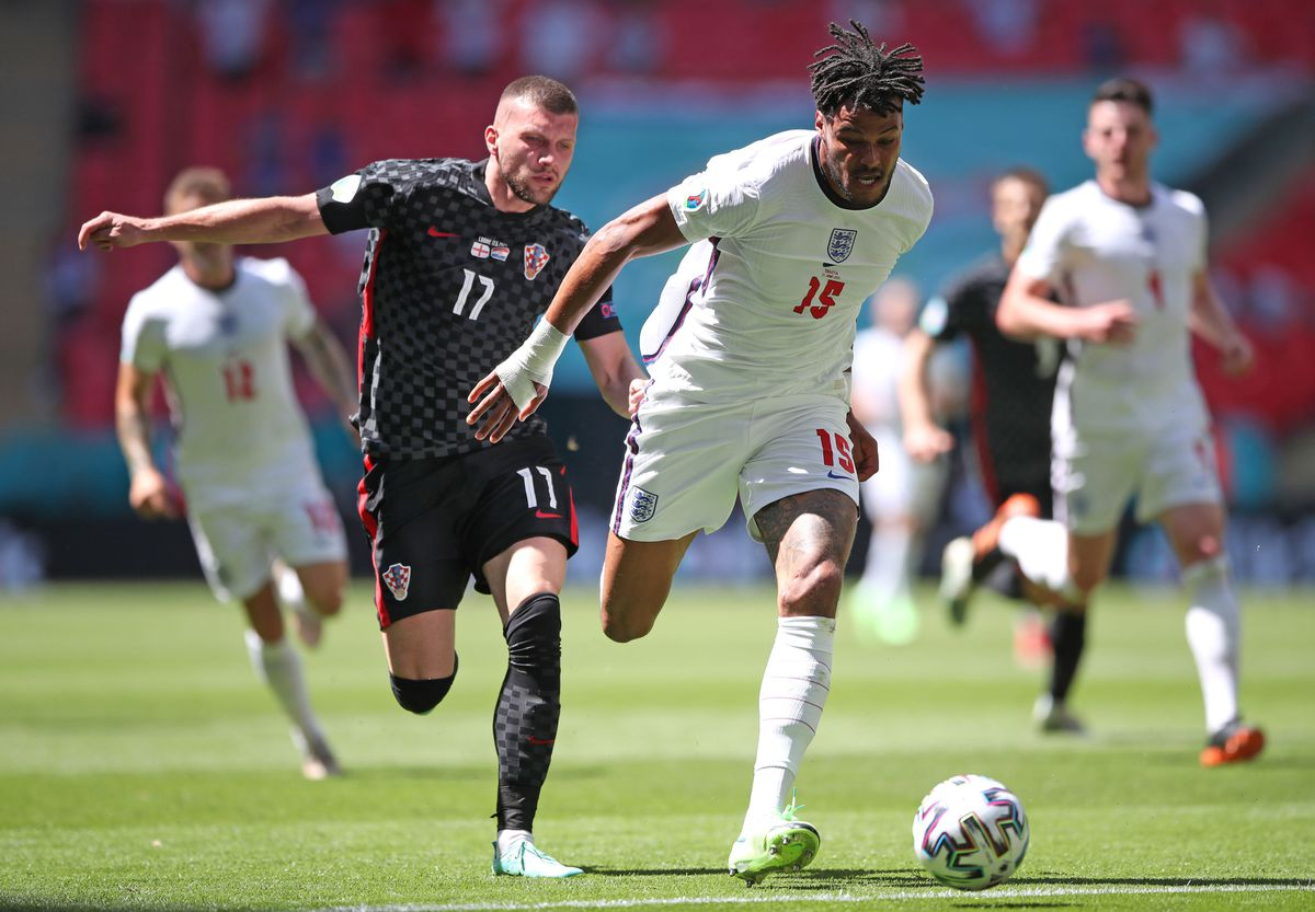Croatia's Ante Rebic (left) and England's Tyrone Mings
