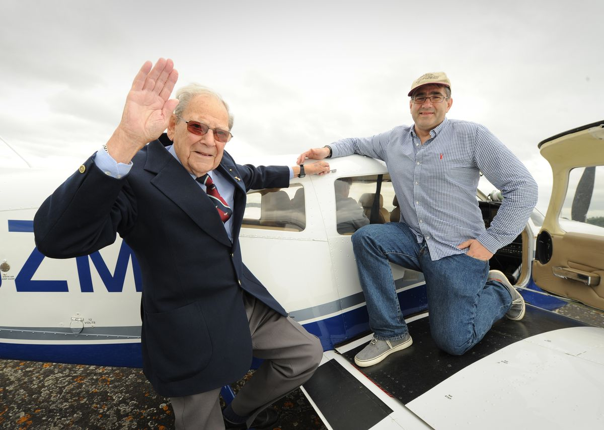 Flying veteran Lancaster gunner John Cuthbert, aged 92, back home, is pilot Ruuben Wells, of Clacton-on-Sea, during an event at Wolverhampton Halfpenny Green Airport