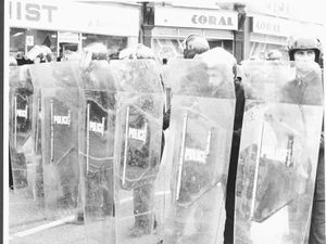 Police facing rioters in Handsworth in July, 1981