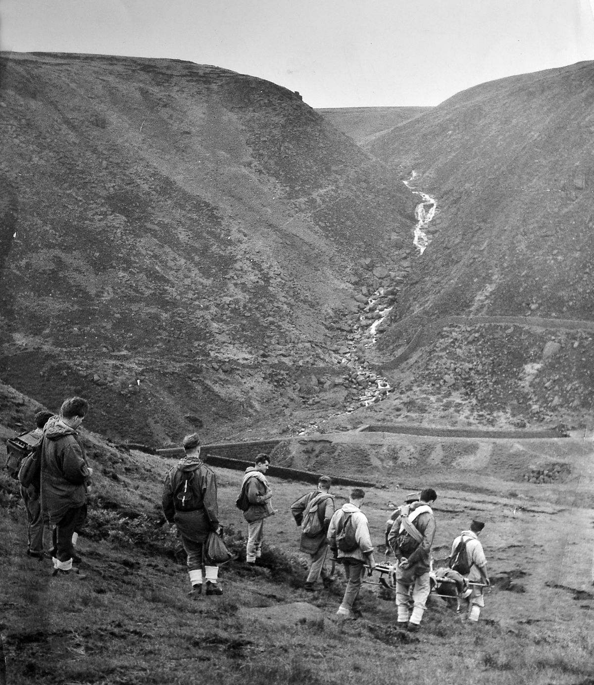 The mountain rescue unit, with stretcher and rescue equipment, set off on a mission in the Peak District in 1960
