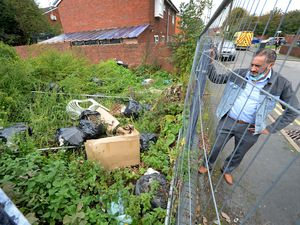 SANDWELL COPYRIGHT EXPRESS&STAR TIM THURSFIELD-14/10/20.Business man Basharat Khan is concerned about fly-tipping taking place on Hopkins Street, Tividale..