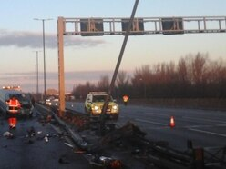 M6 delays after lamppost damaged in crash