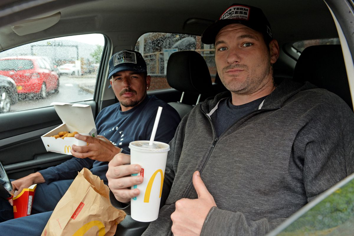 Nathan Lemm and Jay Austin collected their food as McDonald's reopened