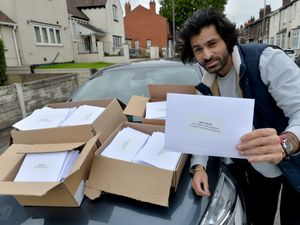 Sarbjit Klair, from Bilston, Wolverhampton, with the letter he is delivering to residents