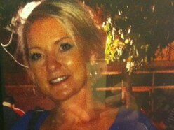 Mother 'dragged to death in rising car park shutter door'
