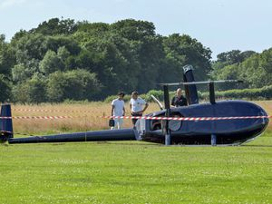A helicopter on its side at Wolverhampton Halfpenny Green Airport. Photo: SnapperSK