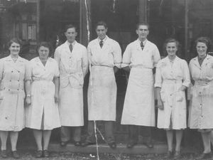 Photograph of staff outside the Hawne Co-op branch (circa late 1940s). Do you know any of these faces?