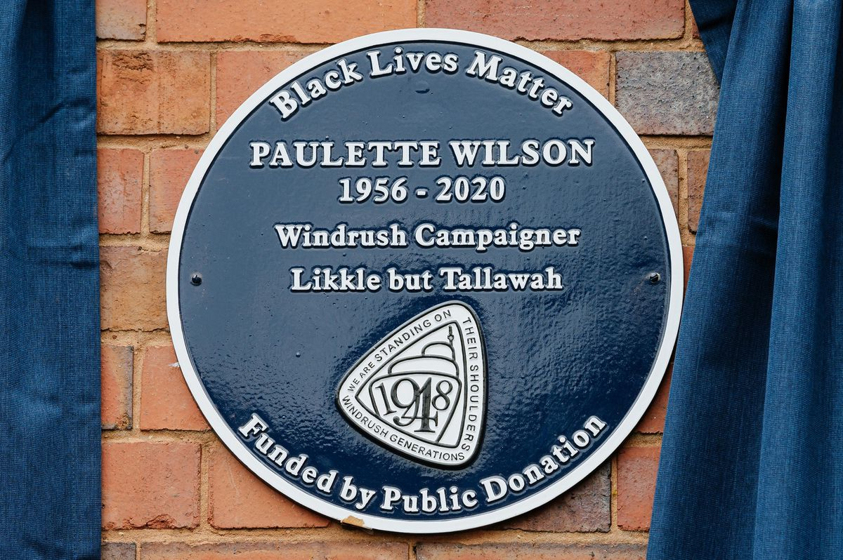 The plaque carries the phrase 'Likkle but Tallawah', a Jamaican phrase meaning 'Little, but Powerful'