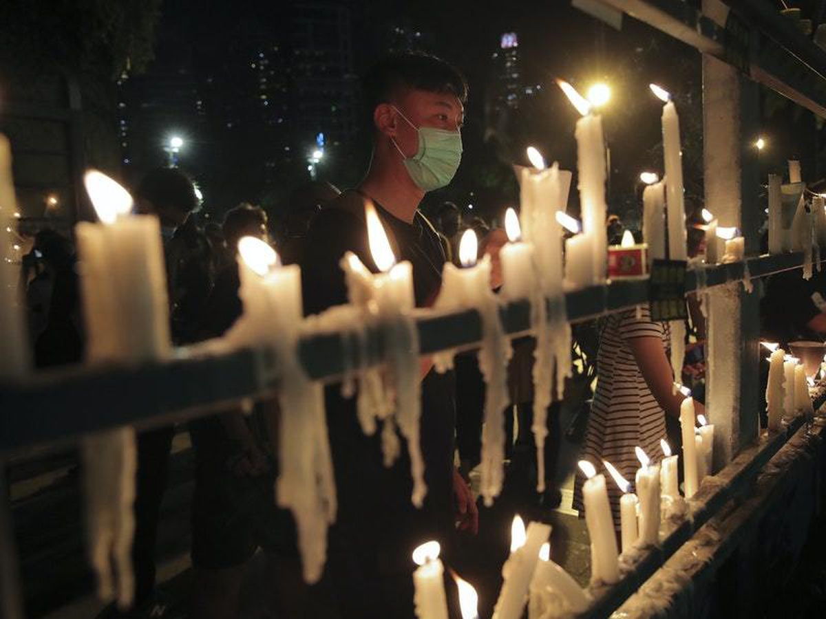 Participants light candles during a vigil for the victims of the 1989 Tiananmen Square Massacre at Victoria Park in Causeway Bay, Hong Kong (KIn Cheung/AP)
