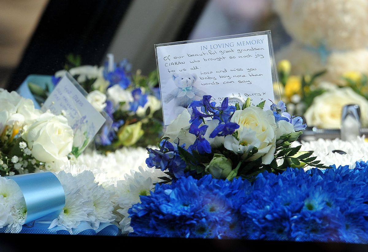 The funeral procession in Brownhills High Street for baby Ciaran Morris