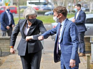 Former Prime Minster Theresa May greets West Midlands Mayor Andy Street in Walsall