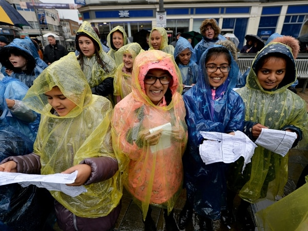 'We're just singing in the rain': Showers failed to dampen city singalong