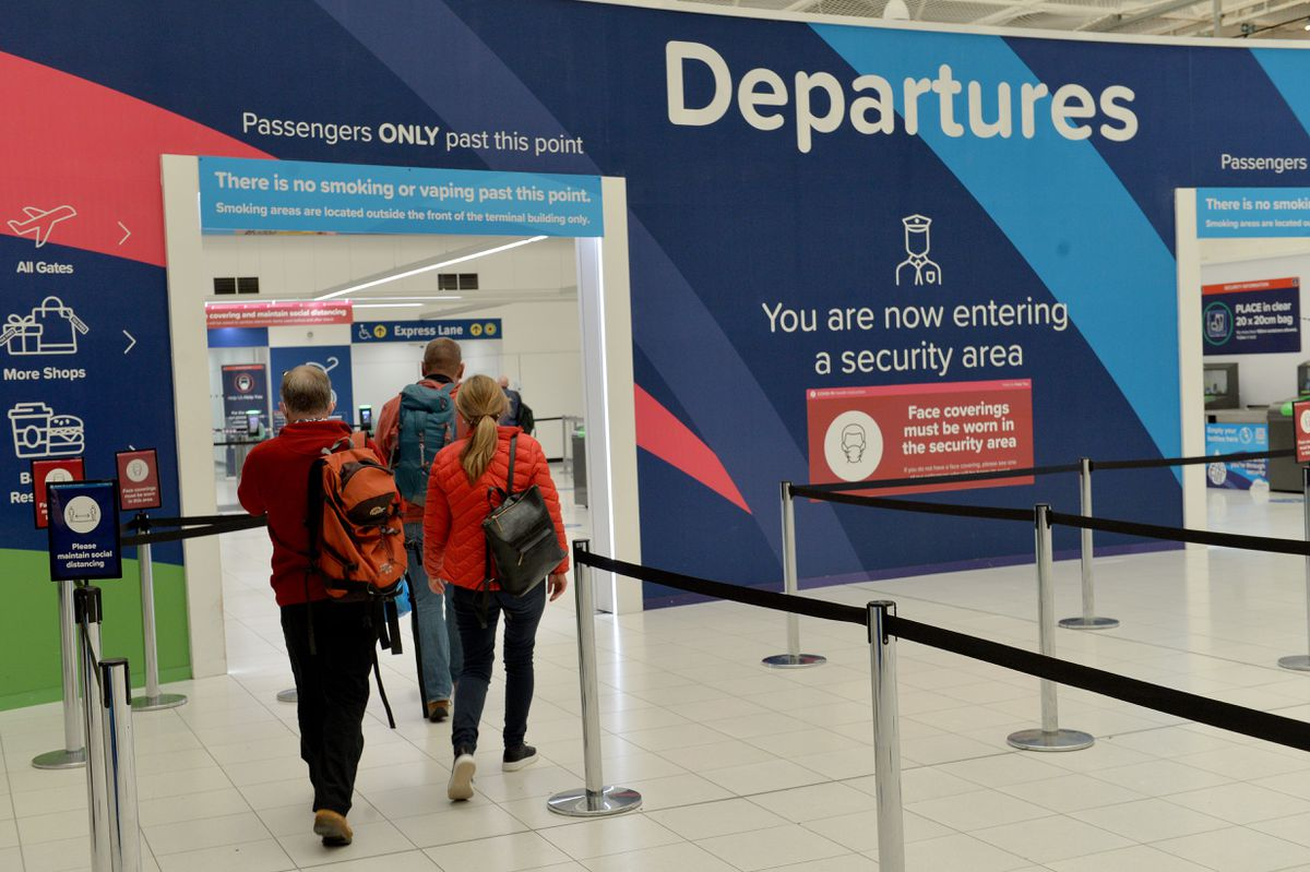 Holidaymakers set off on a flight to Portugal from Birmingham Airport