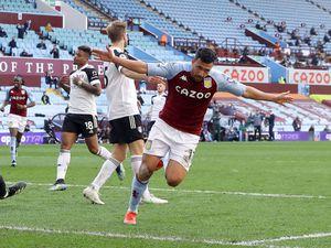 Aston Villa's Trezeguet (right)