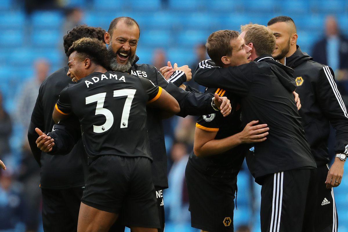 Nuno Espirito Santo celebrates with Adama Traore after the win at Manchester City (AMA)